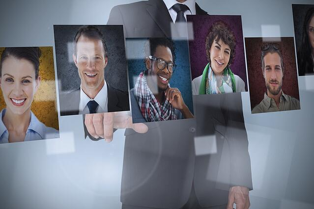 Businessman presenting profile pictures on digital interface.jpeg